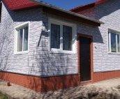 Фасадні панелі Docke Burg: фото будинку