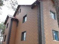 Фасадні панелі Docke фото будинку