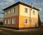 Фасадні панелі Docke Stein: фото будинку
